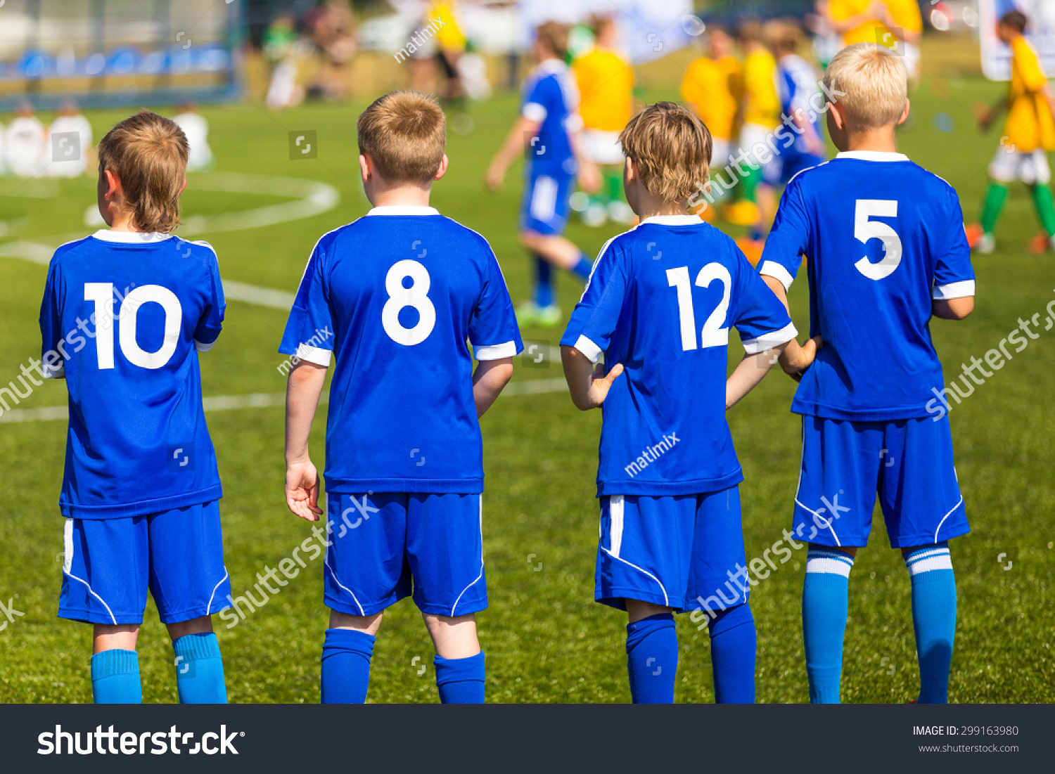stock photo football soccer match children kids waiting bench