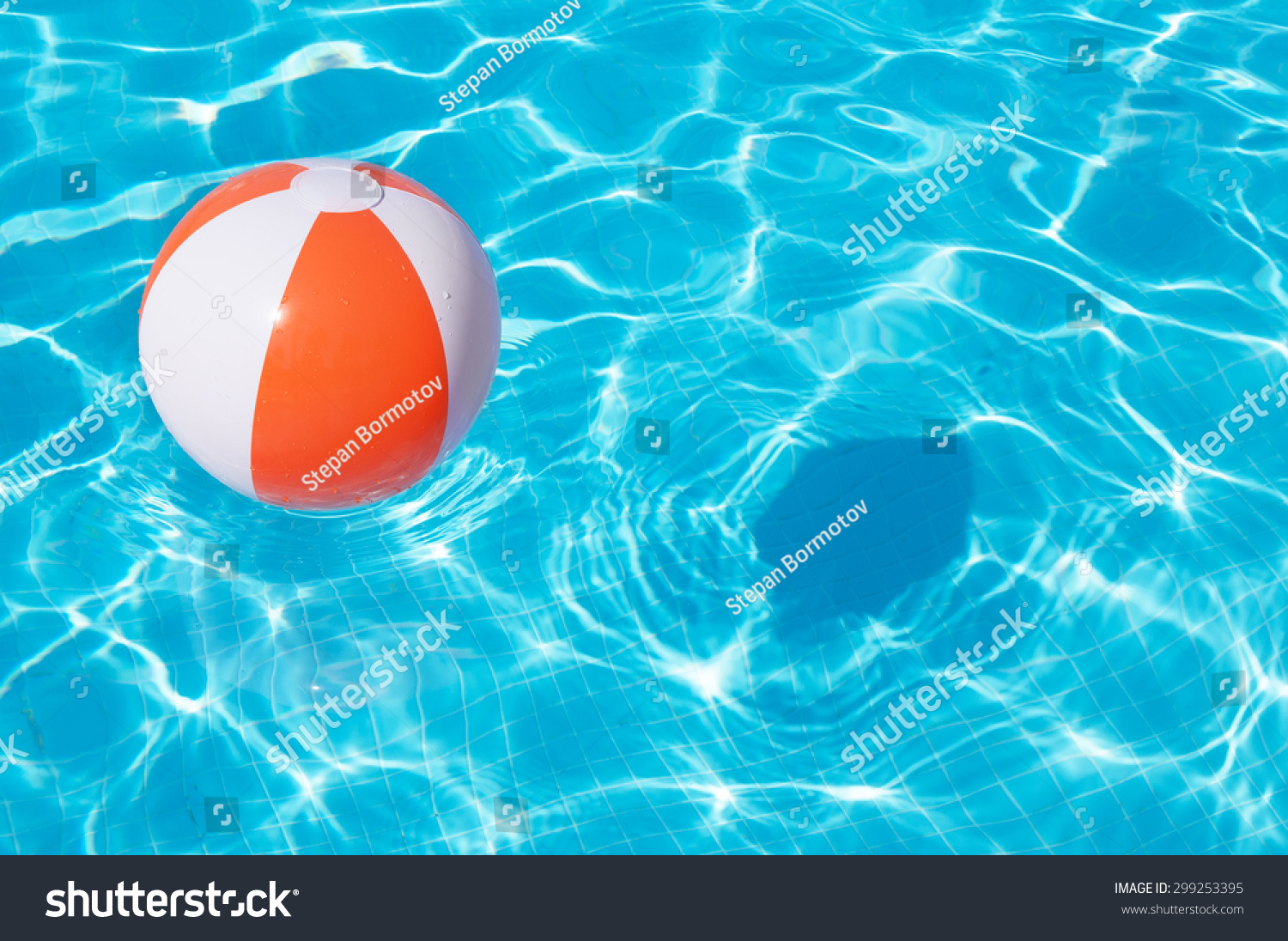 pool water with beach ball. Colorful Beach Ball Floating In A Pool Water With H
