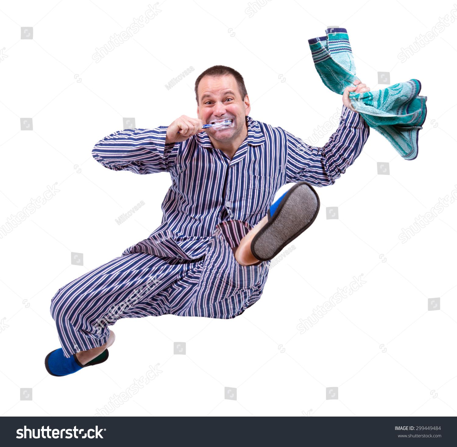 cb8332d7c8 Man in pajamas jumping isolated on a white background. Morning rush. A man  cleans