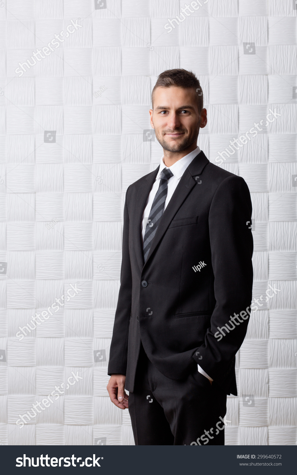 young handsome businessman smiling camera shorthaired stock photo young handsome businessman smiling for the camera short haired tall man in black business