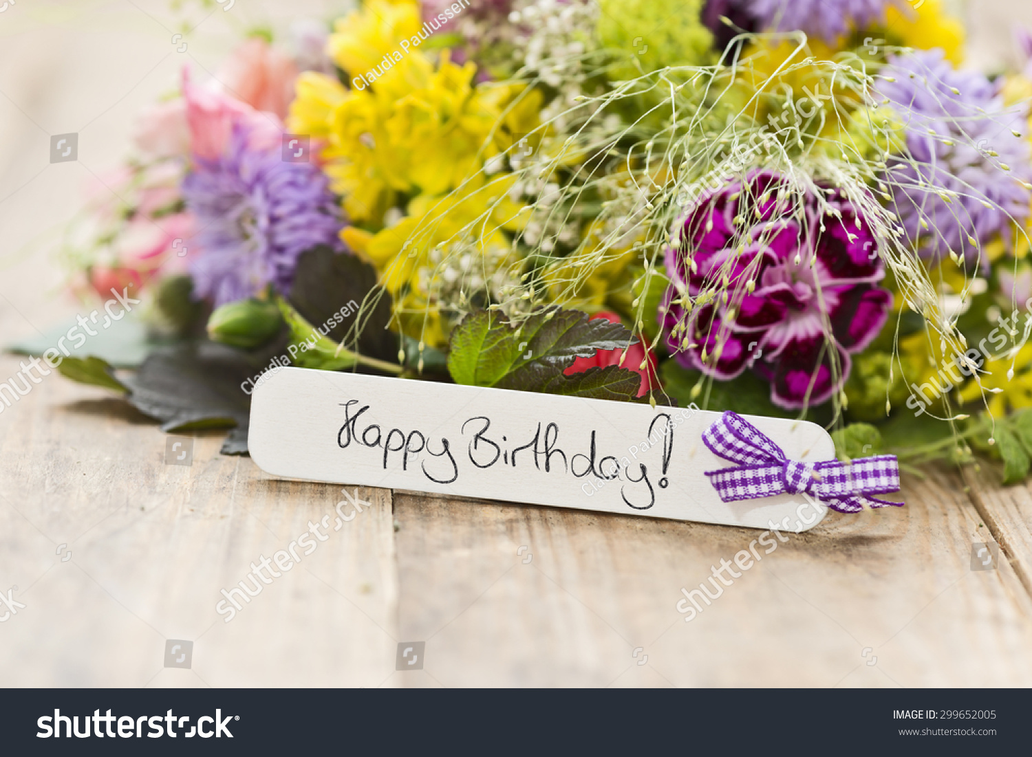 Bouquet flowers tag saying happy birthday stock photo 100 legal a bouquet of flowers with a tag saying happy birthday izmirmasajfo