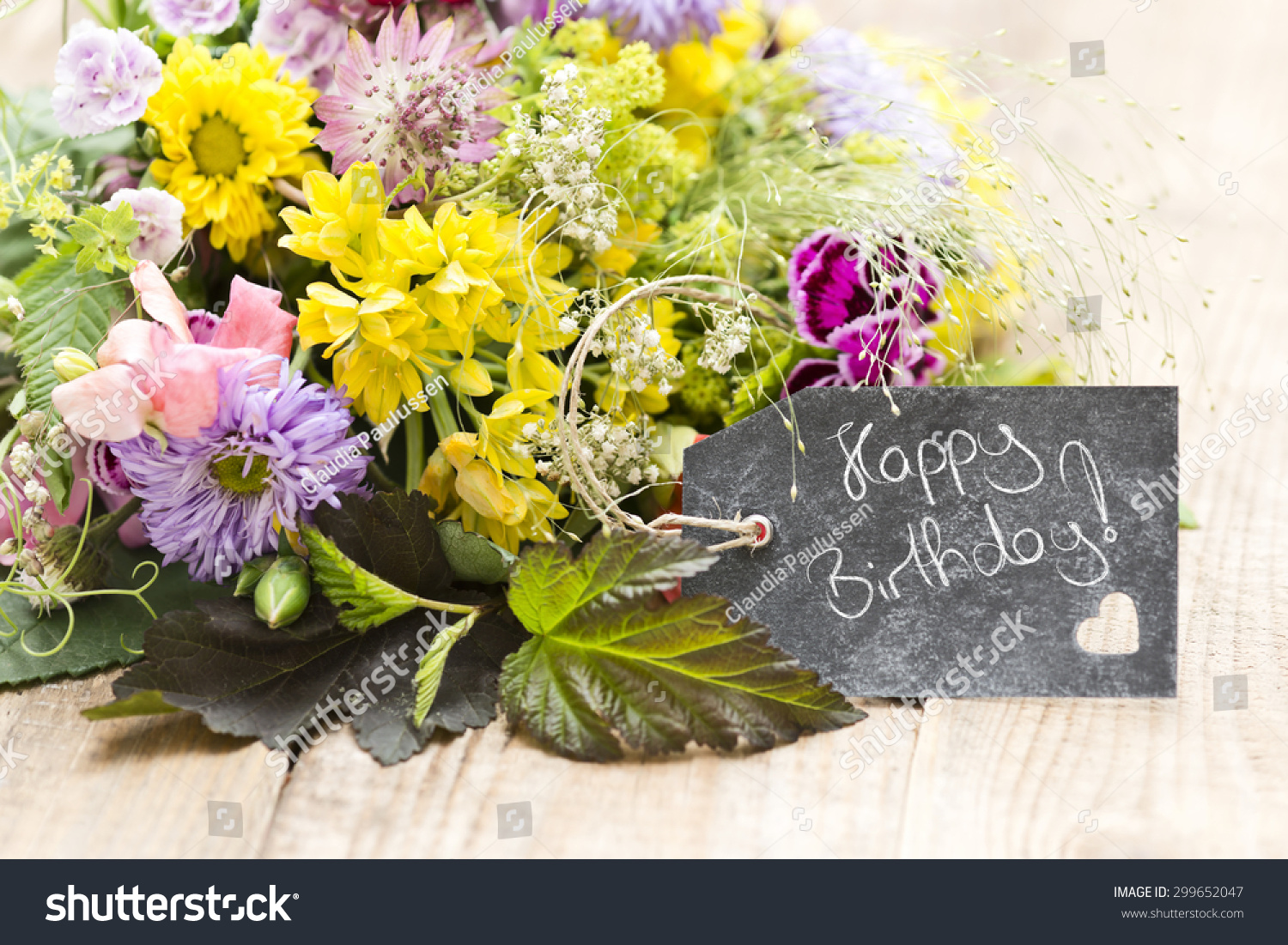 Bouquet flowers tag saying happy birthday stock photo edit now a bouquet of flowers with a tag saying happy birthday izmirmasajfo