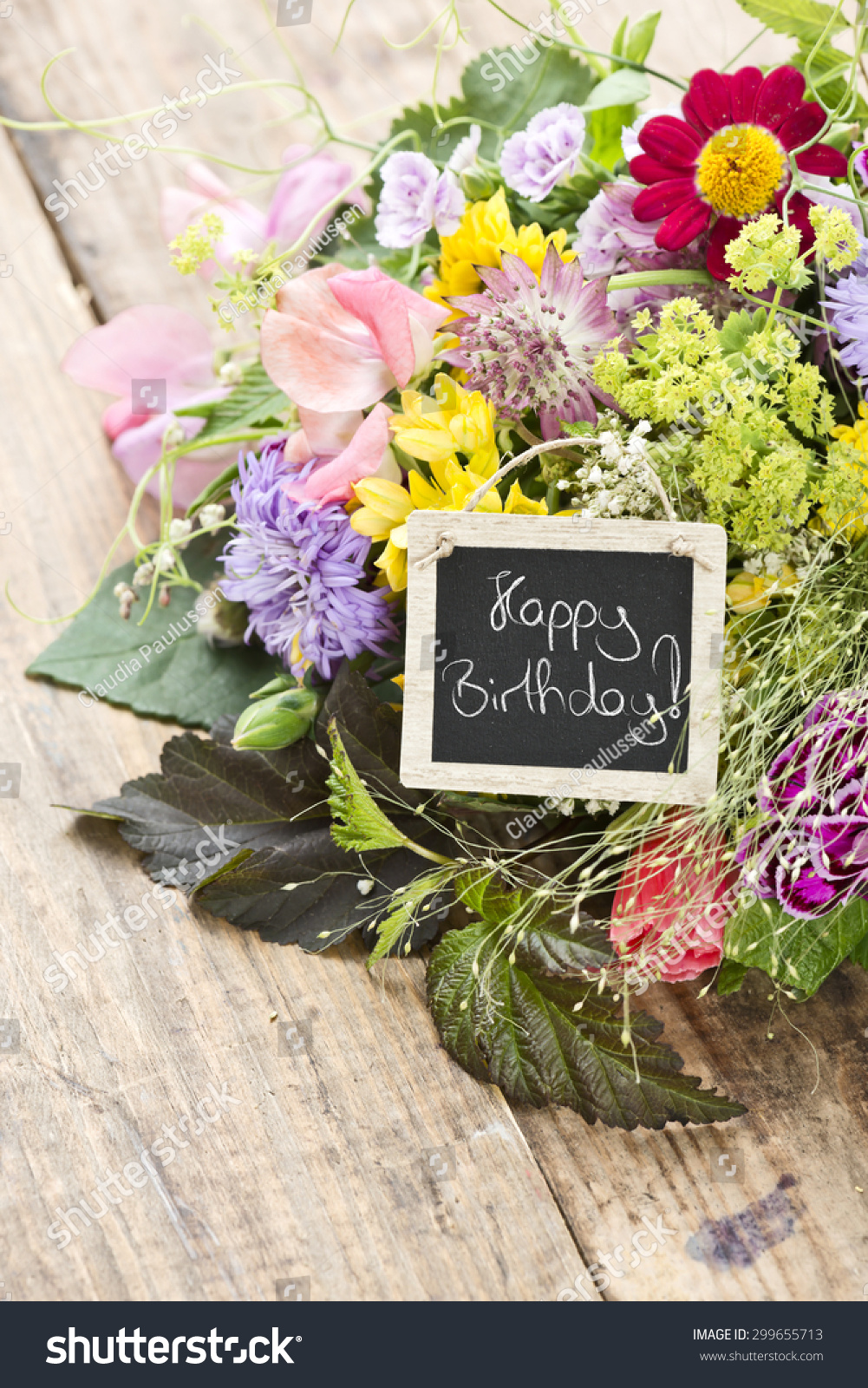 Bouquet flowers tag saying happy birthday stock photo royalty free a bouquet of flowers with a tag saying happy birthday izmirmasajfo