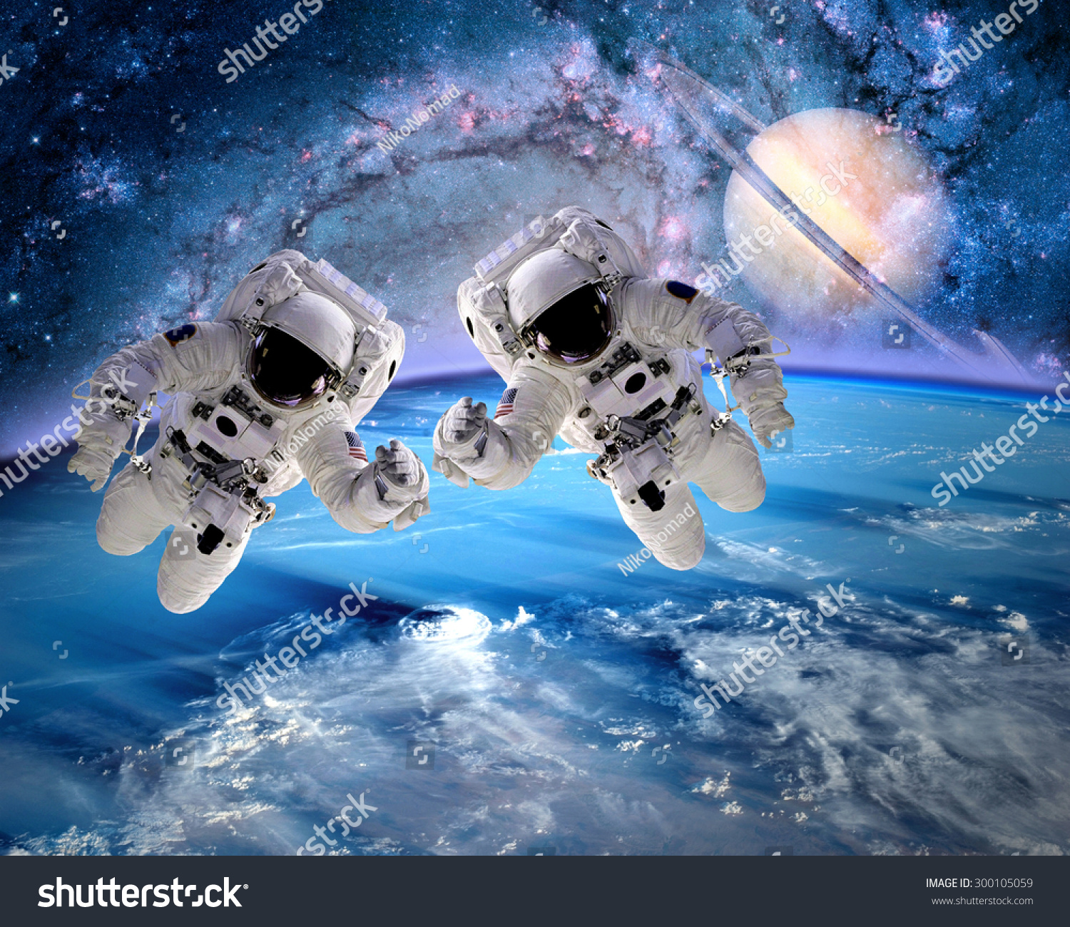 Two astronauts spaceman outer space saturn stock photo for Outer space elements