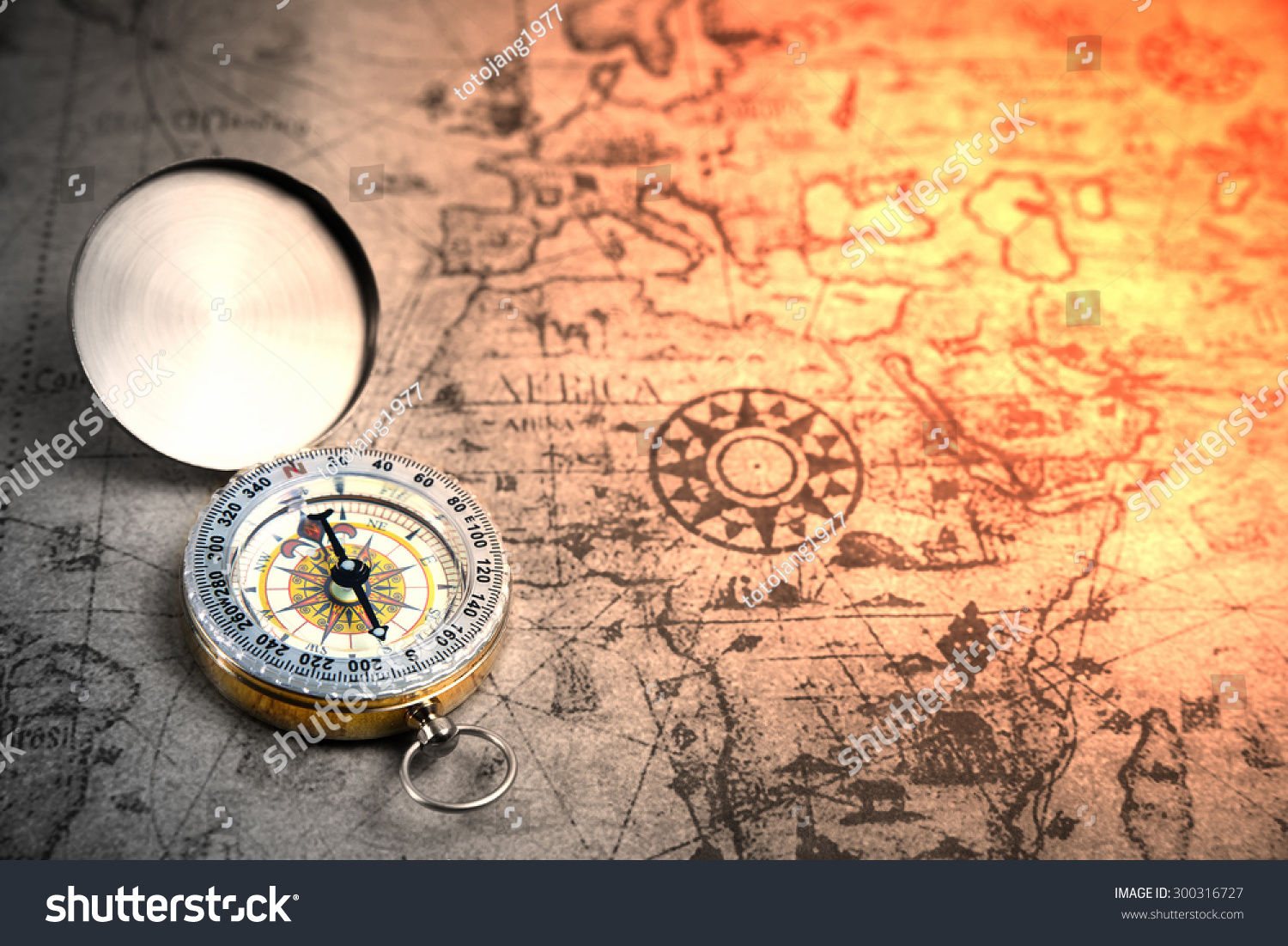 Retro compass on ancient world map stock photo royalty free retro compass on ancient world map vintage style gumiabroncs Image collections