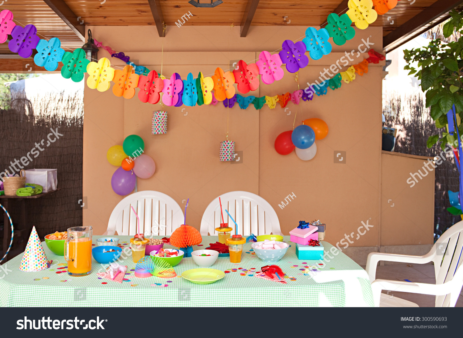 Birthday table decorations at home - Still Life View Of A Children Birthday Party Table Decorated With Fun And Colorful Deco And