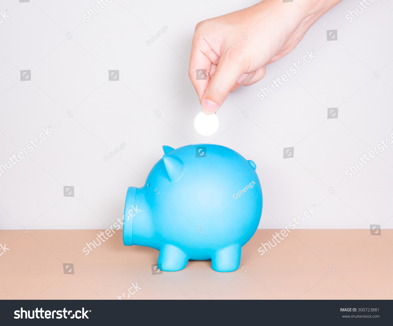 saving money hand putting coin into stock photo 300723881