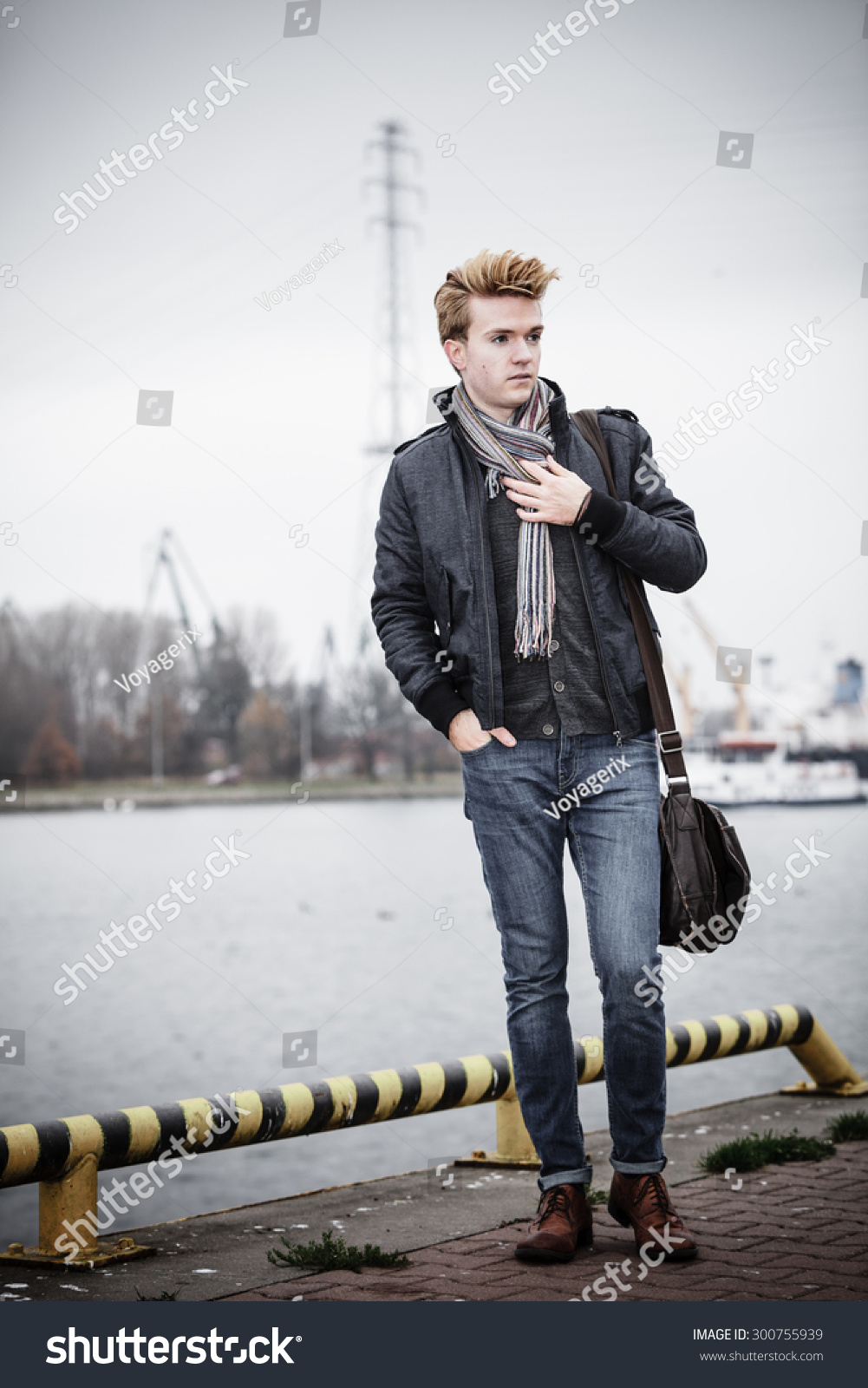 Full Length Young Handsome Man Fashion Model Casual Style With Bag On Street Urban Industrial Background Stock Photo