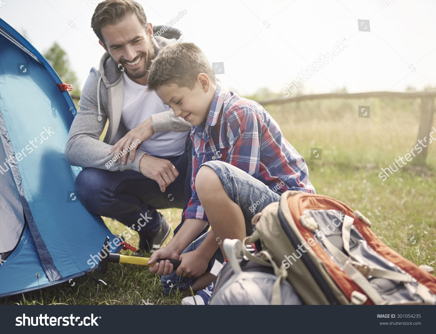 Father teaching son how to pitch a tent  sc 1 st  Shutterstock & Father Teaching Son How Pitch Tent Stock Photo 301054235 ...