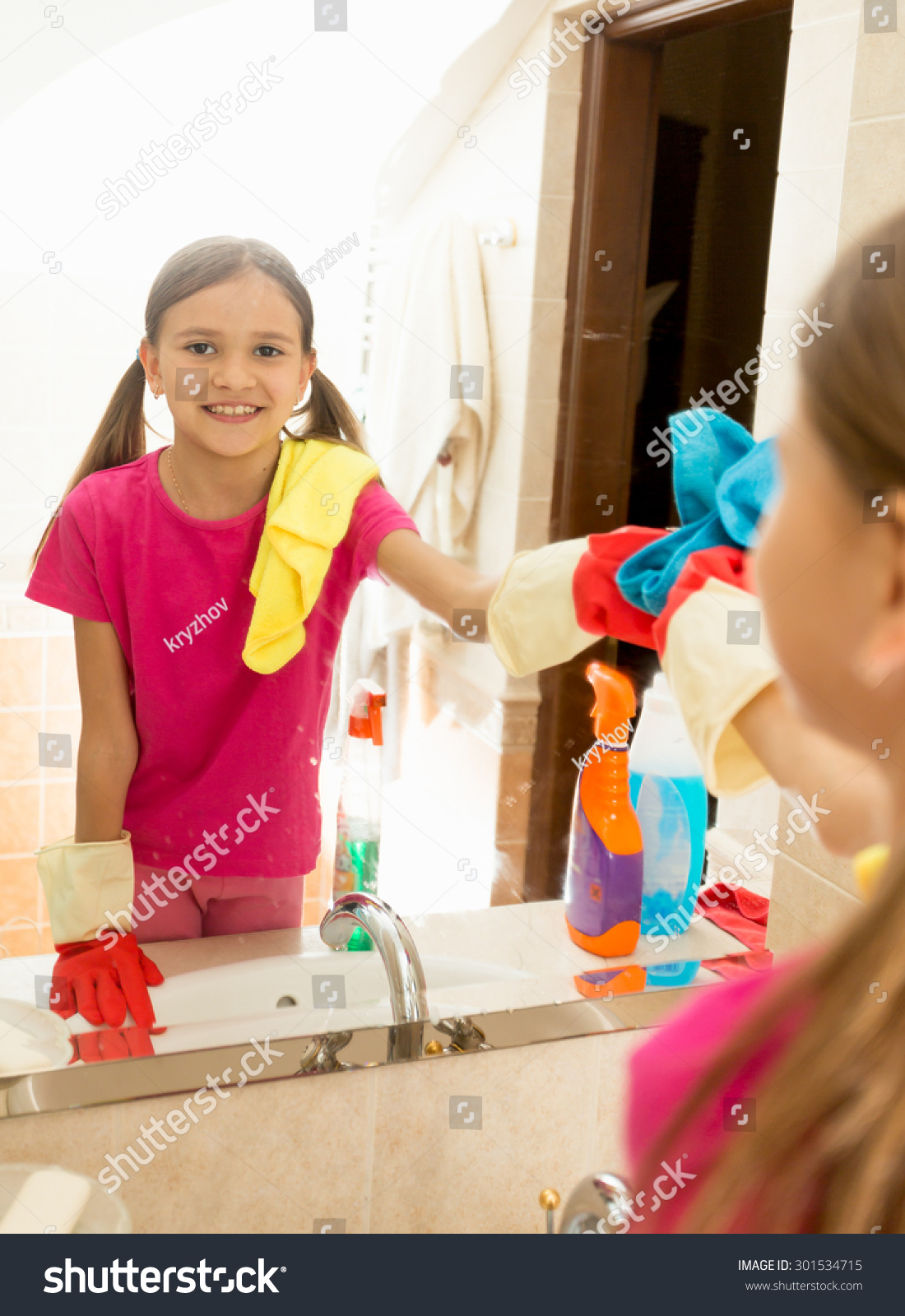 How to clean bathroom mirror - Teen Girl Helping At Housework And Cleaning Bathroom Mirror