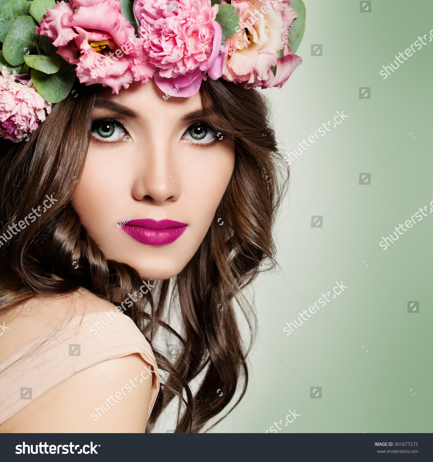 Royalty free beautiful girl with flowers wreath 301677272 stock beautiful girl with flowers wreath long permed curly hair and fashion makeup blossom portrait of pretty young woman with pink flowers stock photo izmirmasajfo Image collections