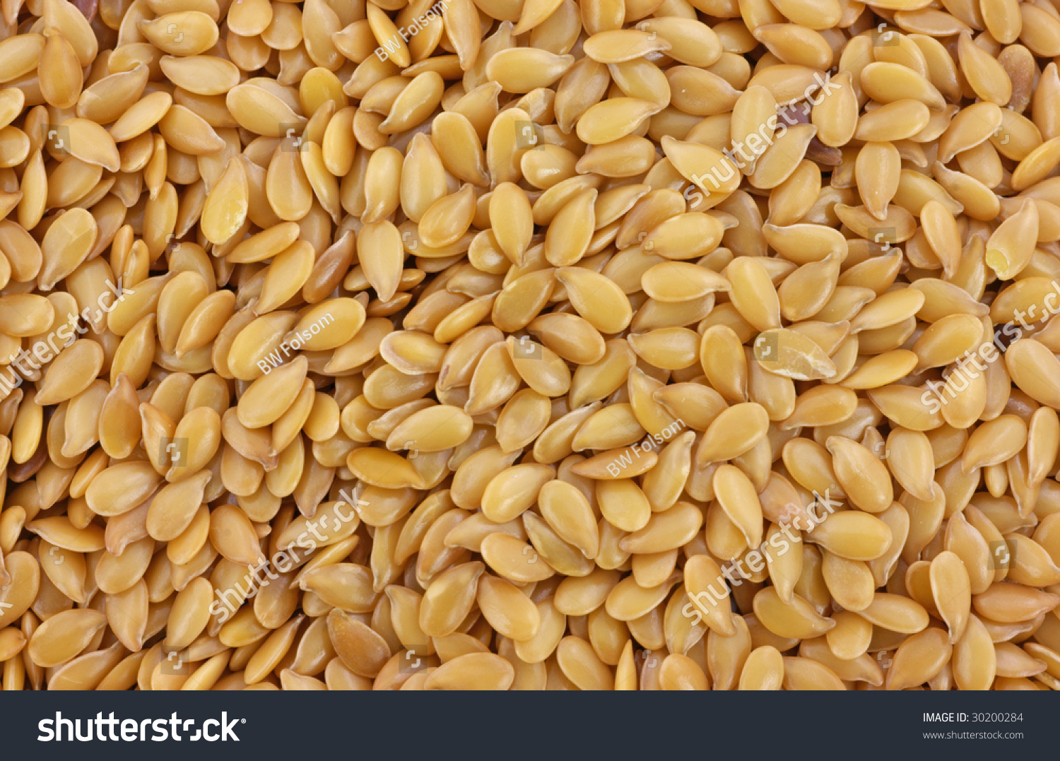 Macro view of organic golden flax seeds #30200284