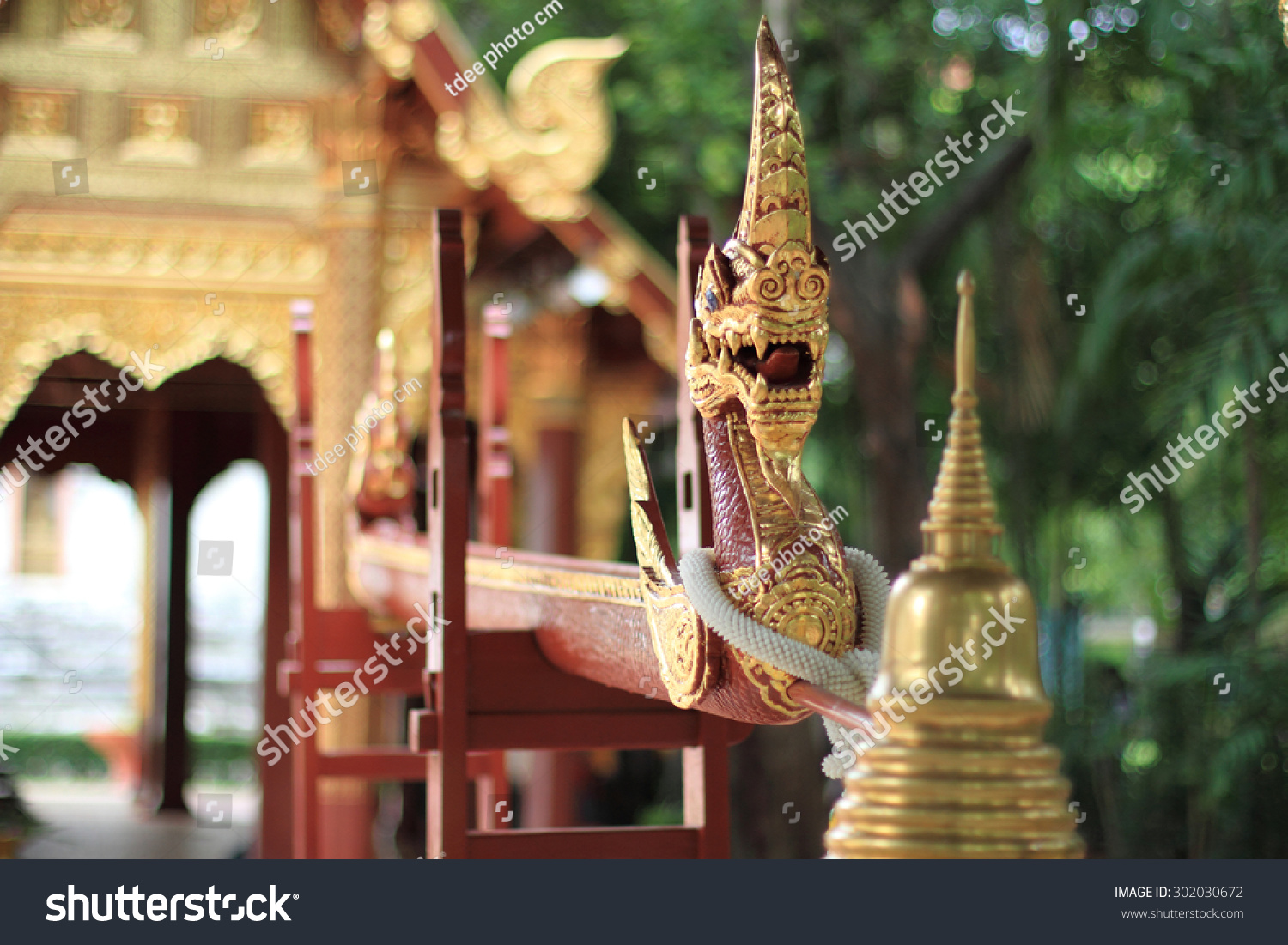 Naga made of wood carving Ancient Thai style art