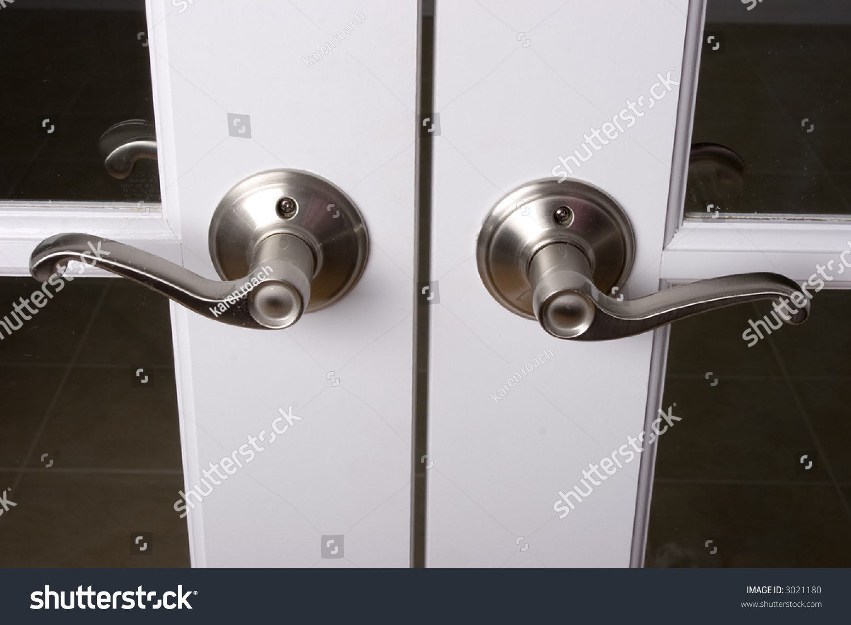 French Door Hardware : Lever door handles on french doors stock photo