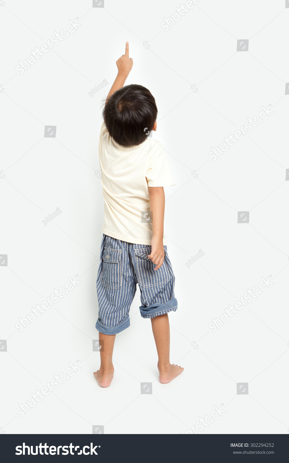 Child Pointing Wall Back View Isolated Stock Photo ...