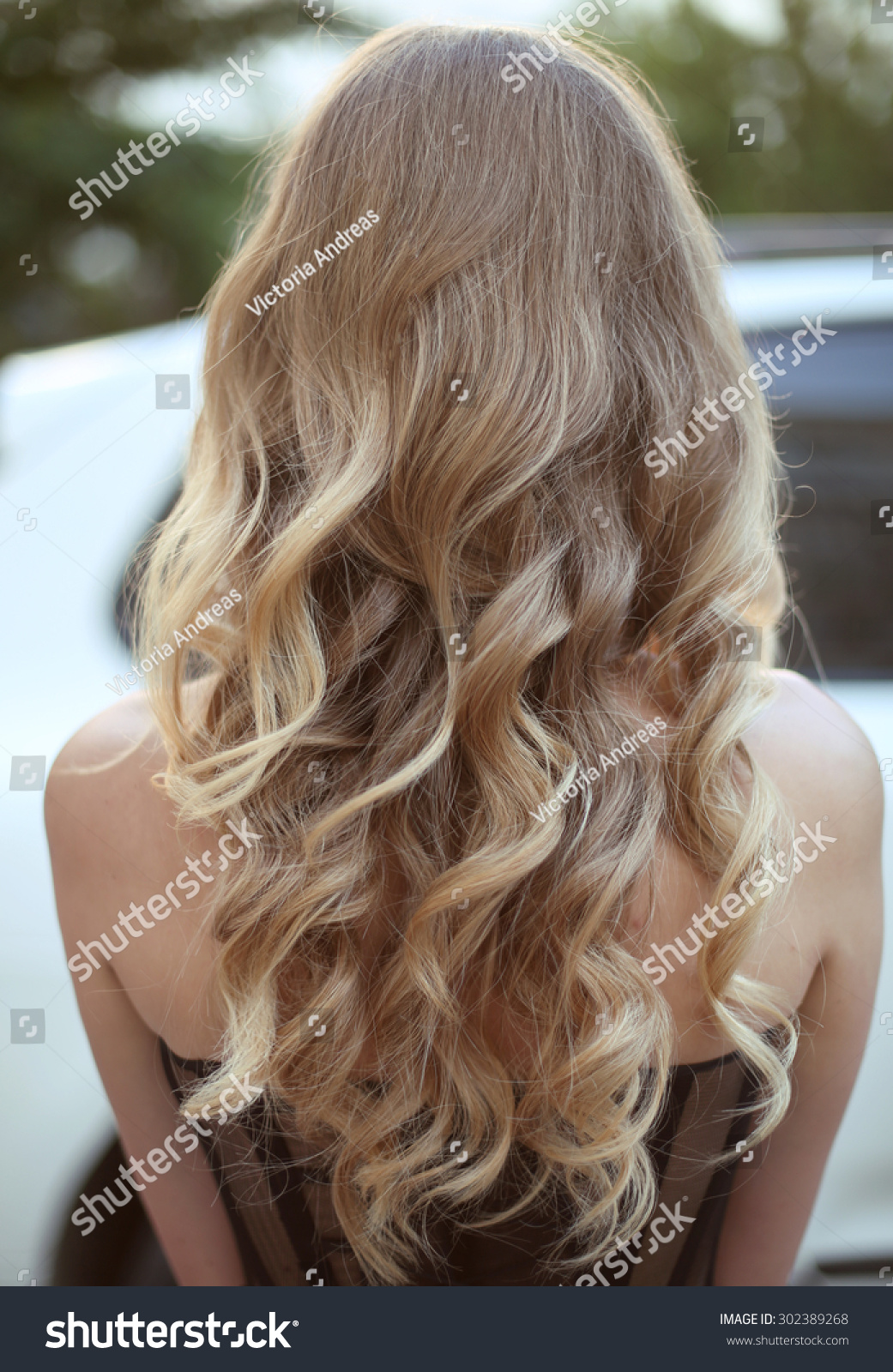 healthy hair curly long hairstyle back view of blond