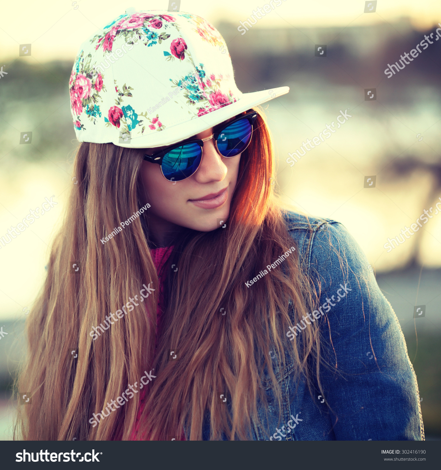 outdoor fashion portrait of stylish swag girl wearing