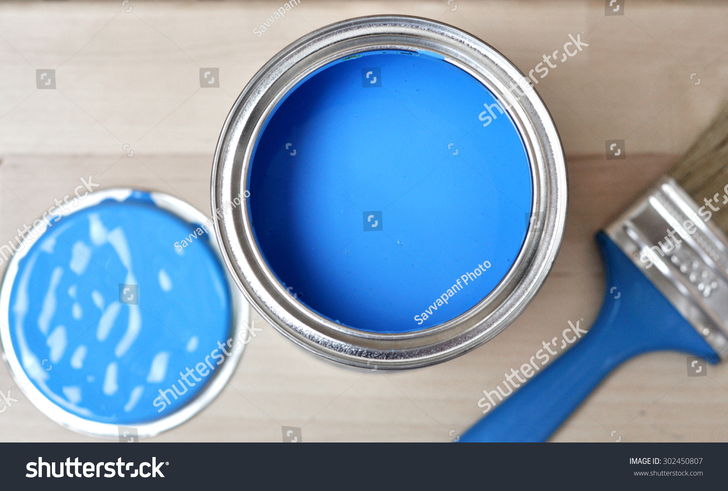 Full of blue paint tin and paint brush