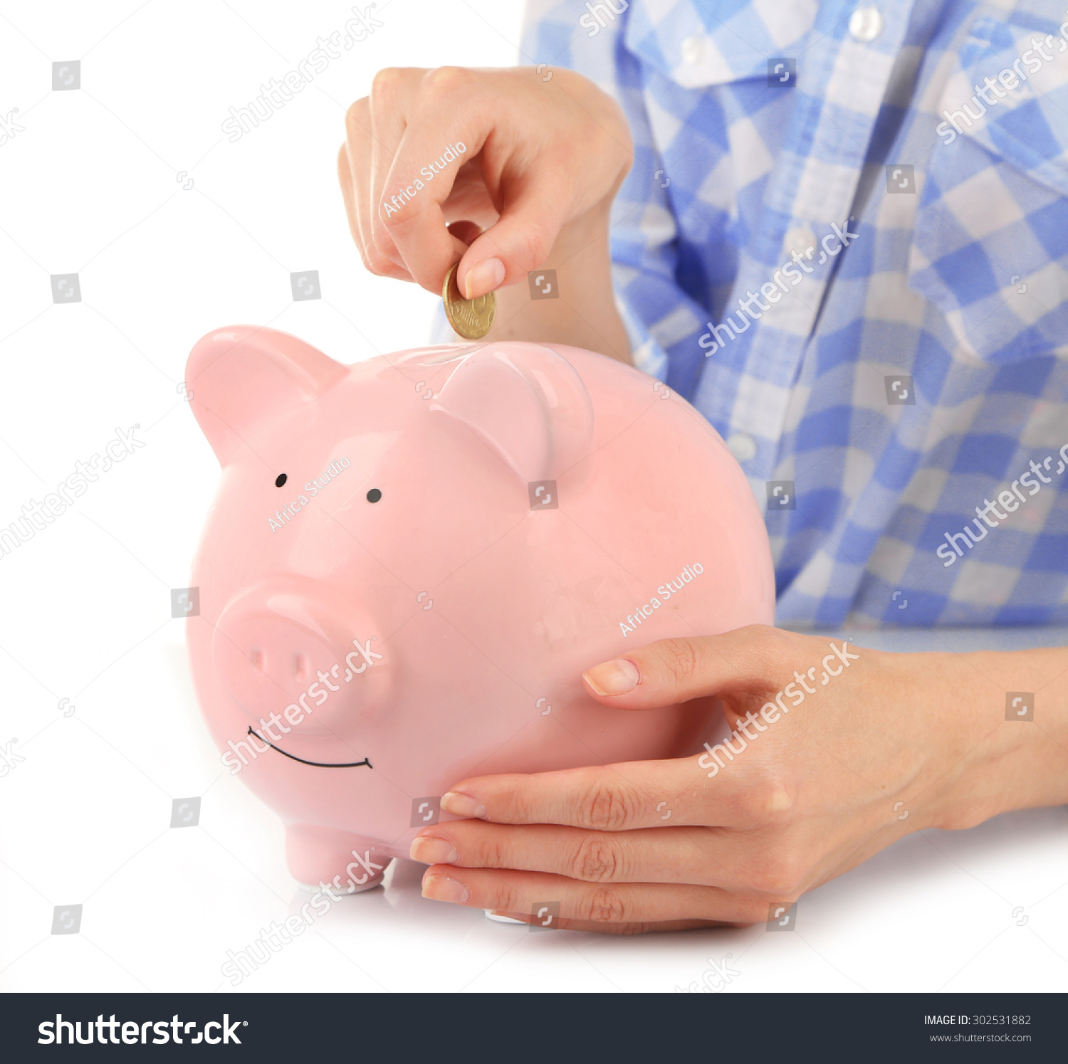 female hands putting coin into pink stock photo 302531882