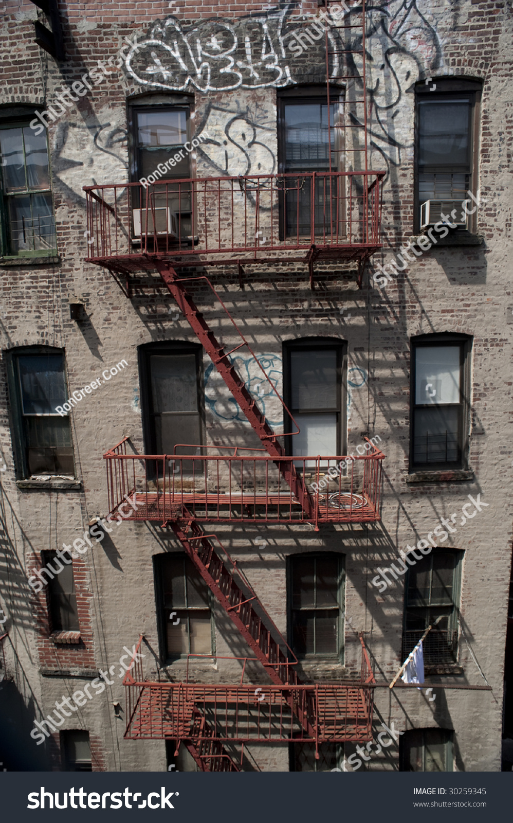 Old Brick Apartment Building With Fire Escape And Graffiti., New York City Part 76