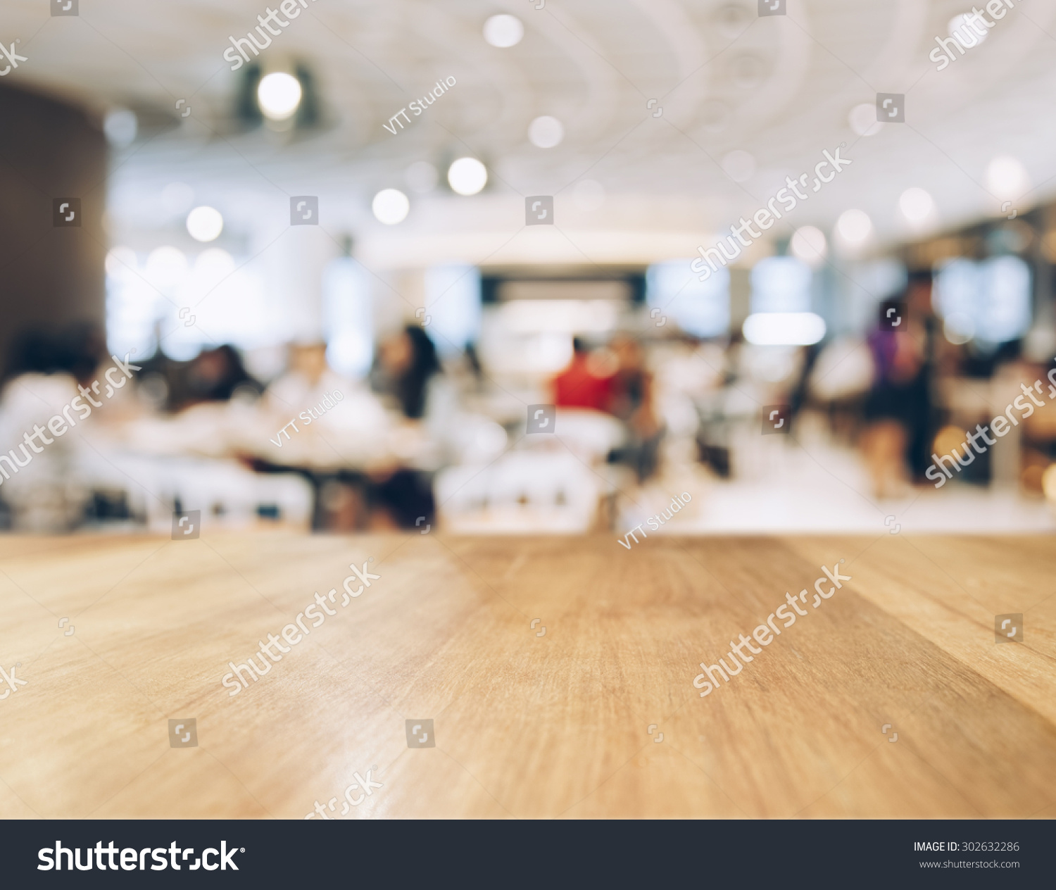 Table top counter with blurred people and restaurant shop