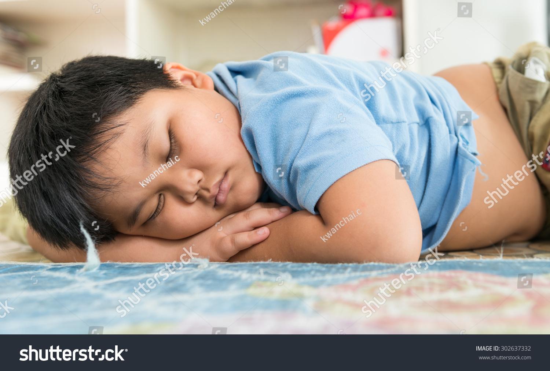Fat boy sleep dream on his arm 302637332