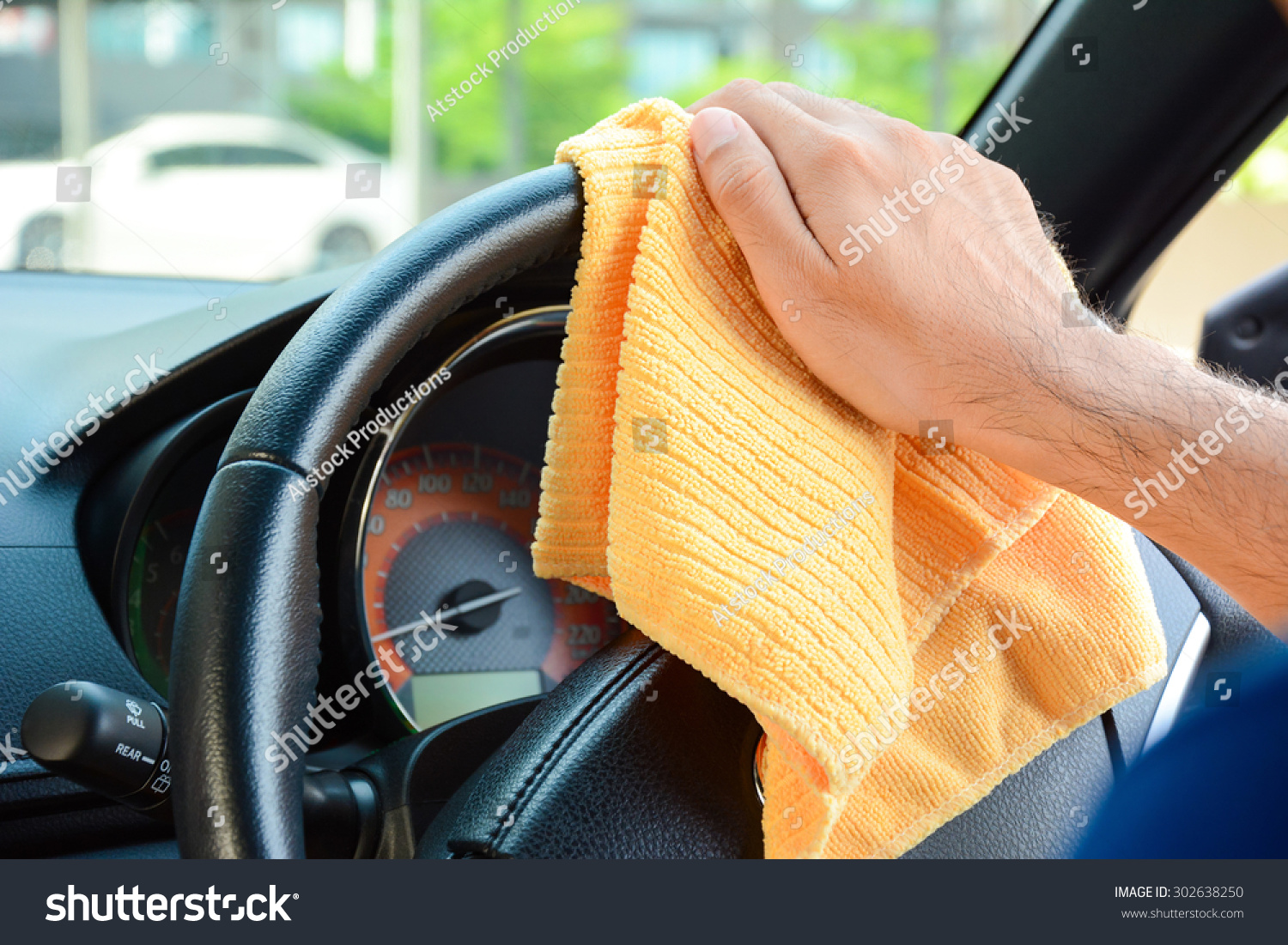 hand cleaning car steering wheel microfiber stock photo 302638250 shutterstock. Black Bedroom Furniture Sets. Home Design Ideas