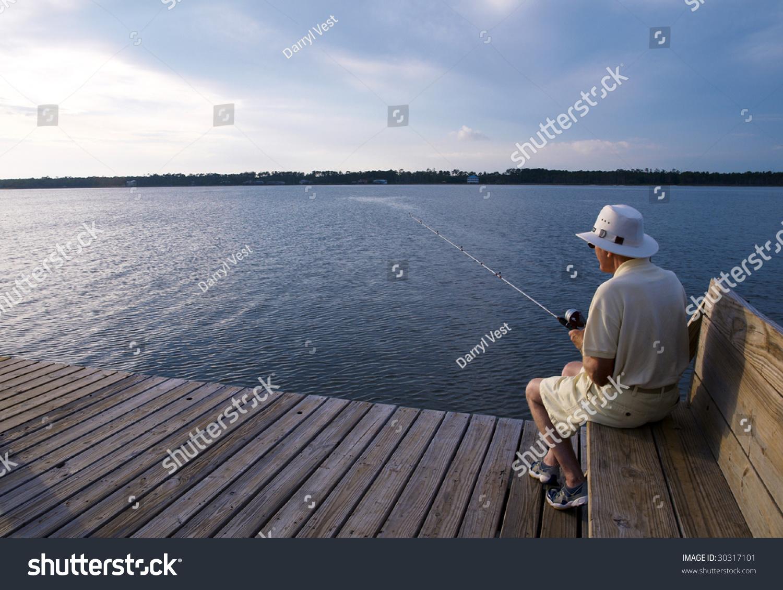 Senior man fishing alone pier stock photo 30317101 for Senior fishing license