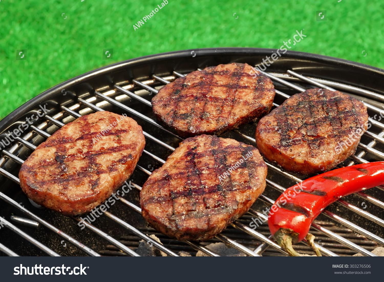 closeup bbq hamburger patties chili pepper stock photo 303276506
