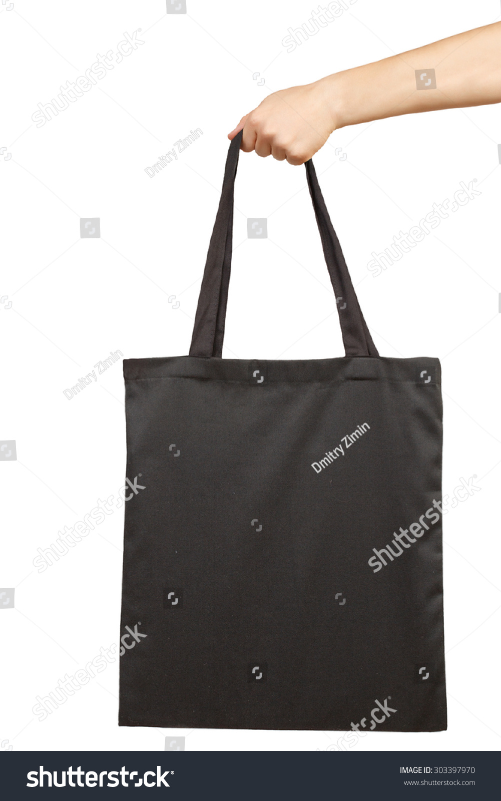 White apron mockup - Hand Holding Blank Fabric Tote Bag Isolated On White