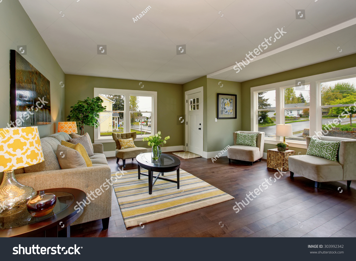 Well Decorated Living Room With Hardwood Floor And Green Yellow Theme Stock Photo 303992342
