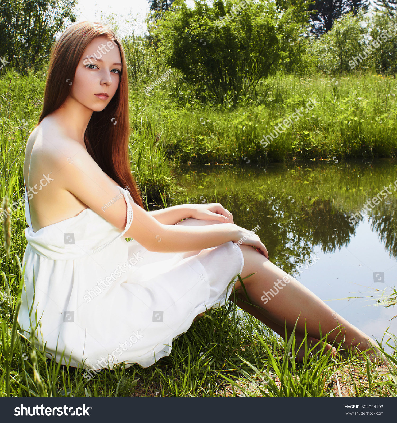 sexy beautiful girl white dress lowered stock photo