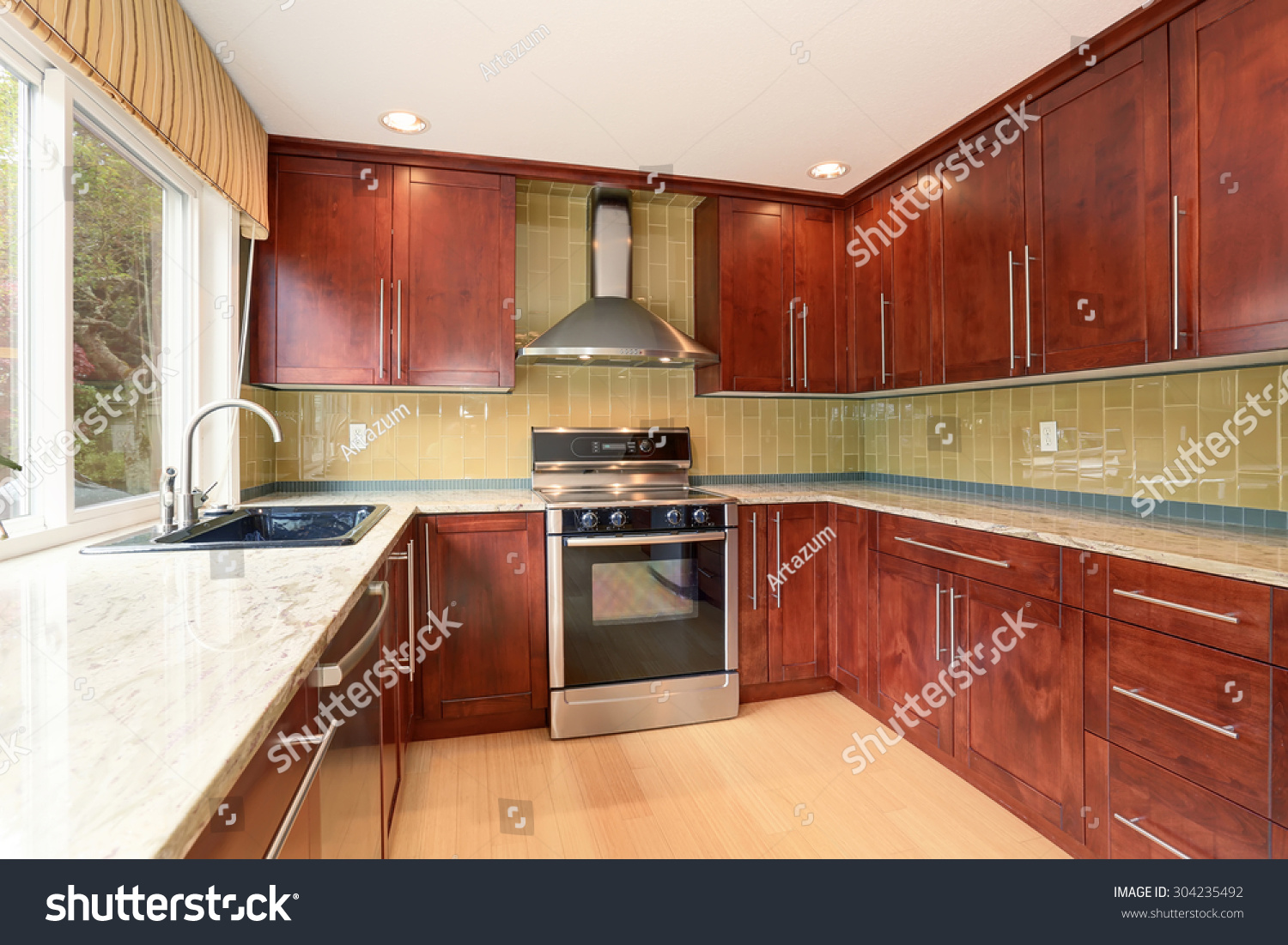 Clean style kitchen stained wood cabinets stock photo for Best product to clean wood kitchen cabinets