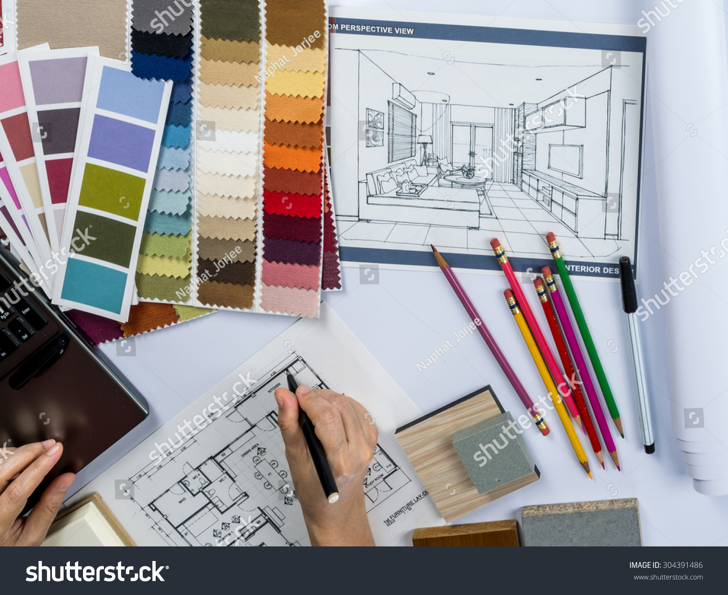 Top view of architects hands drawing of modern house with material sample on creative desk #304391486