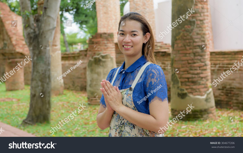 Thai Woman Standing Hands Clasped Sawasdee Stock Photo Edit Now