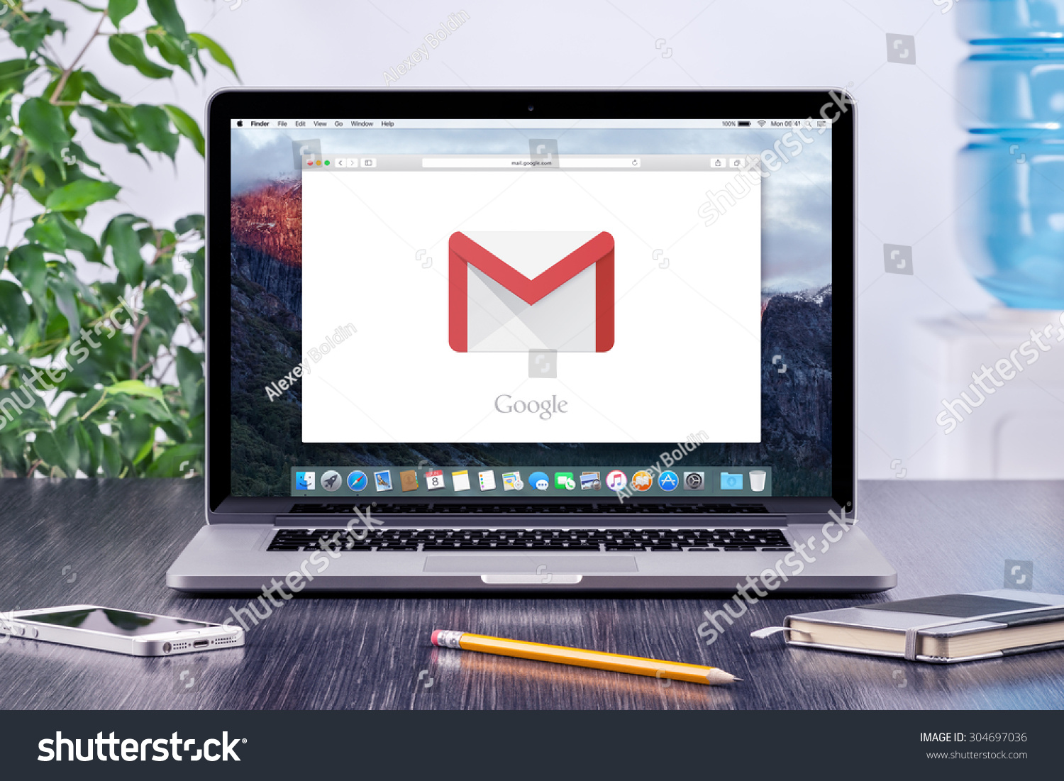 Google Gmail Logo On The Apple Macbook Pro Display That Is On Office Desk Workplace. Gmail Is A ...
