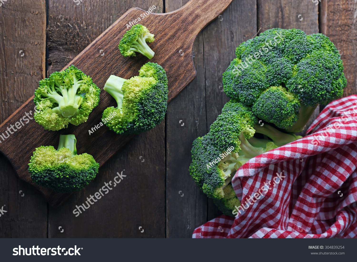 Fresh broccoli on wooden table close stock photo
