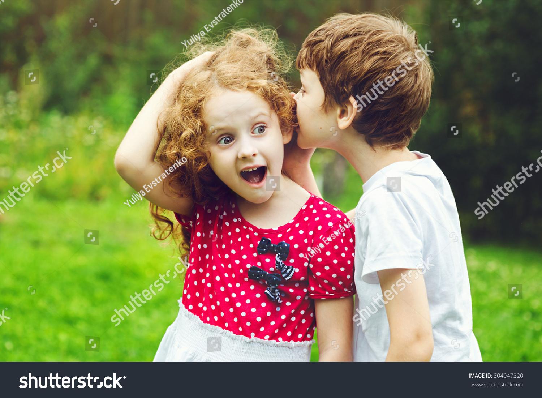 Little Boy Girl Whispers Stock Photo (Edit Now) 304947320