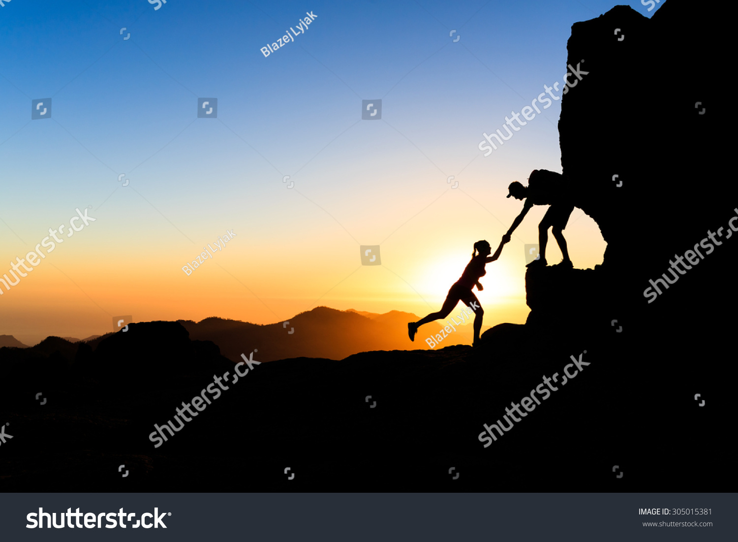 teamwork trust couple helping hand trust stock photo  teamwork trust couple helping hand trust help silhouette in mountains team of climbers man and