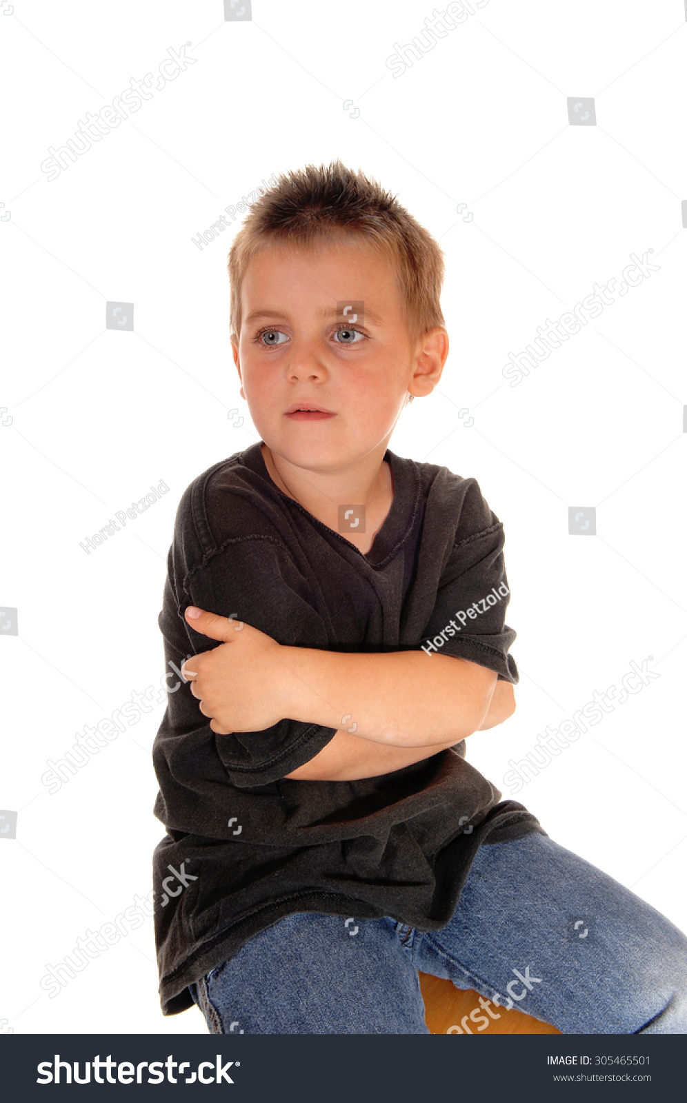 Black child sitting in chair - A Beautiful Young Boy Sitting On A Chair In A Black T Shirt Hugging
