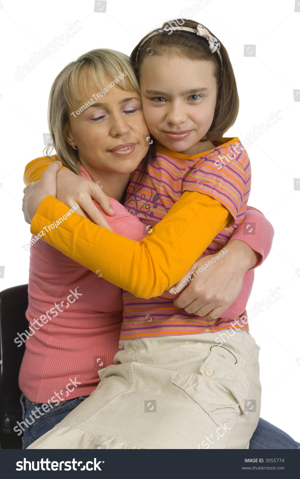 11yo girl naked Hug of woman and her 10-12yo daughter. Daughter is sitting on mother's knees