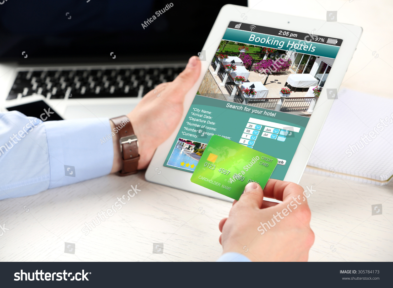 Man holding tablet with screen interface of booking hotels for Tablet hotel booking