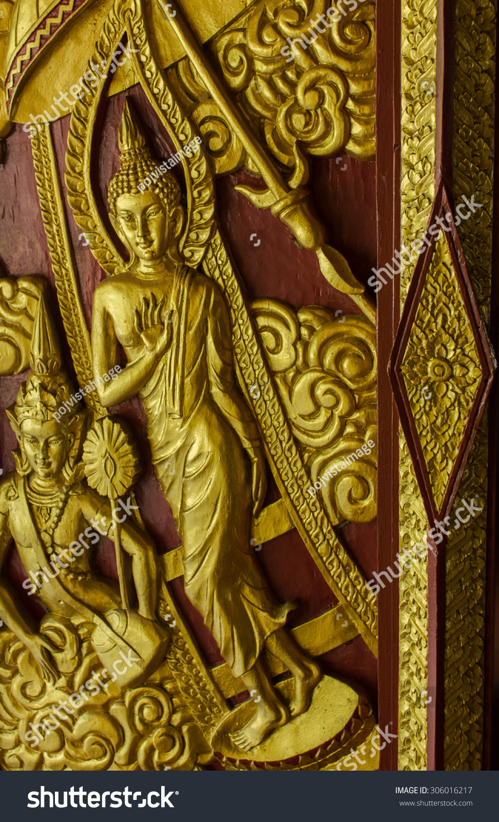 Wood carvings on the temple walls in public. Buddha wooden carving ...