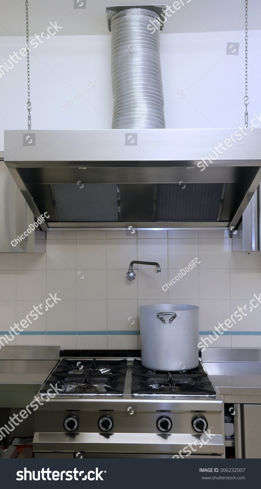 Large Industrial Kitchen Cooker With Aluminum Pot And The Giant Smoke  Ventilation Hood