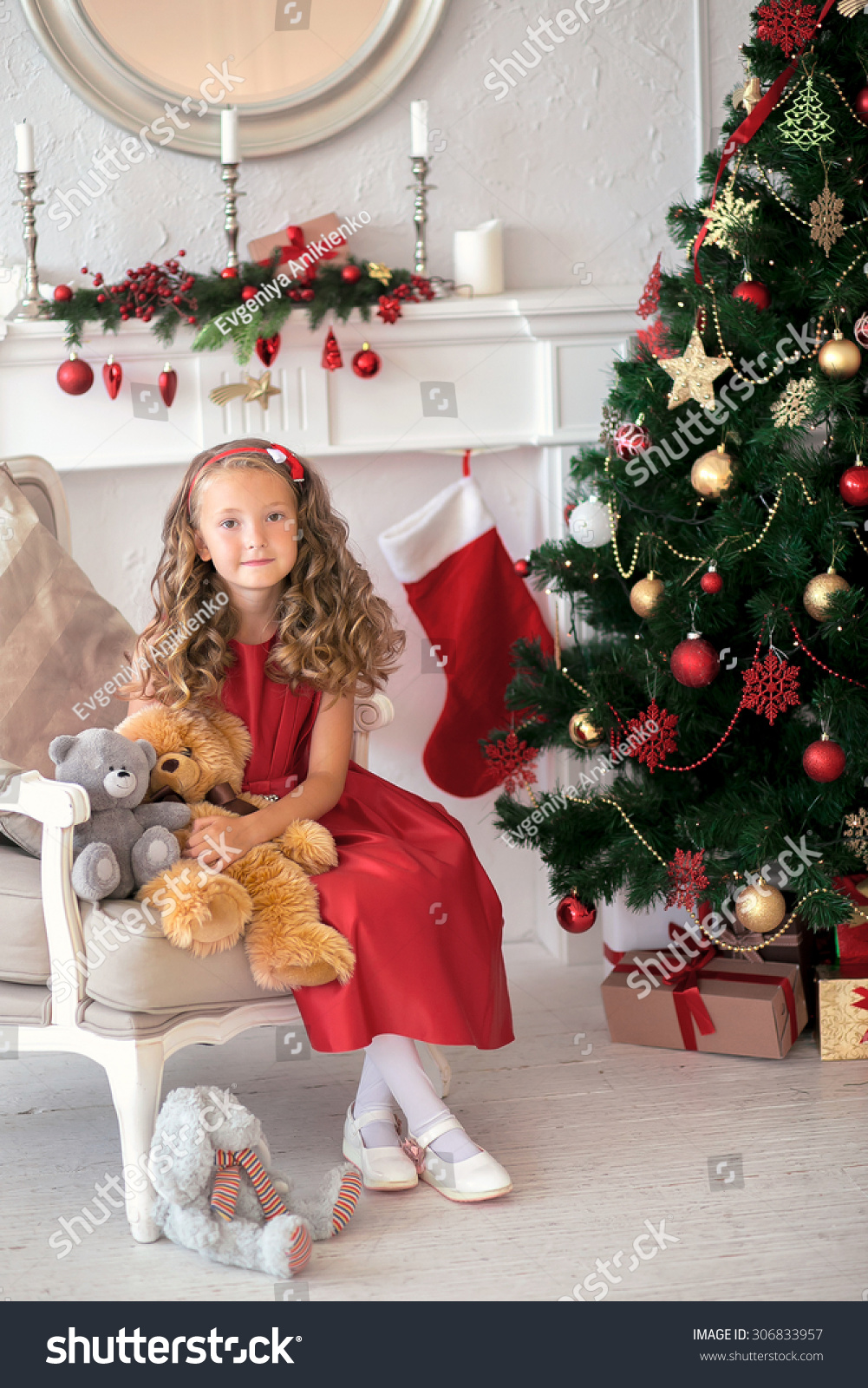 Toys Under Christmas Tree : Merry christmas smiling girl sitting with toys under the