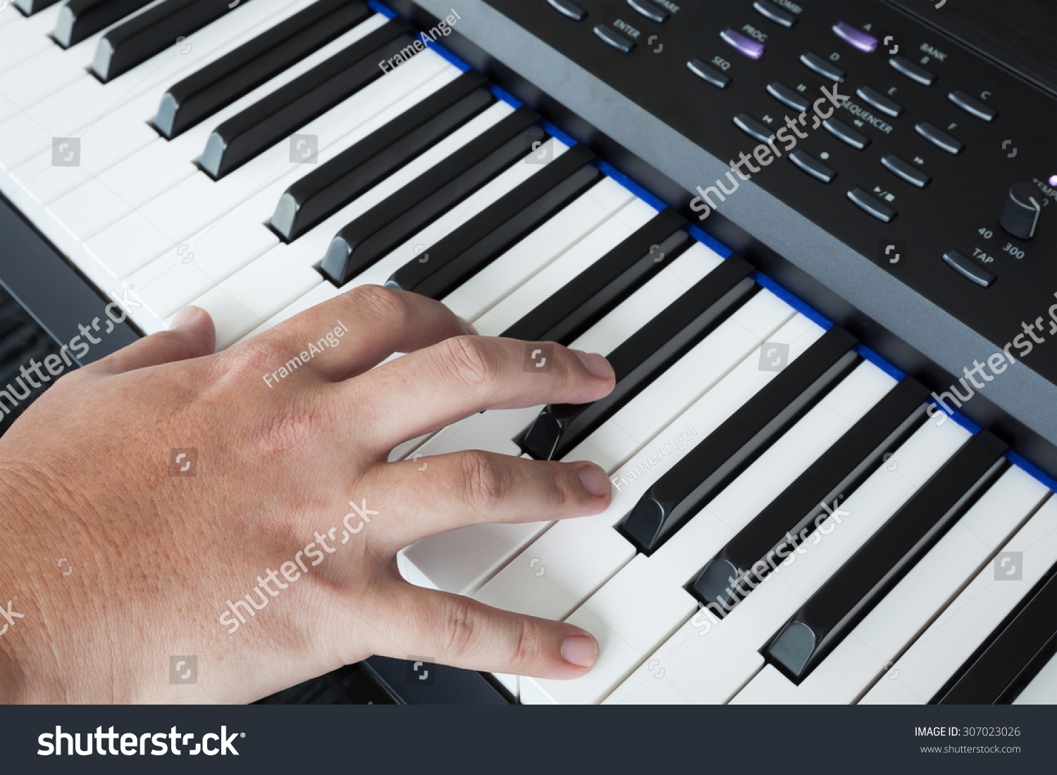 Hand On Piano Keyboard Synthesizer Closeup Stock Photo (Edit Now