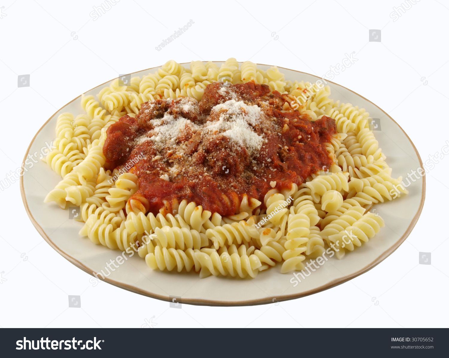 A Plate Of Rotini Pasta With Tomato Sauce And Meatball. Stock