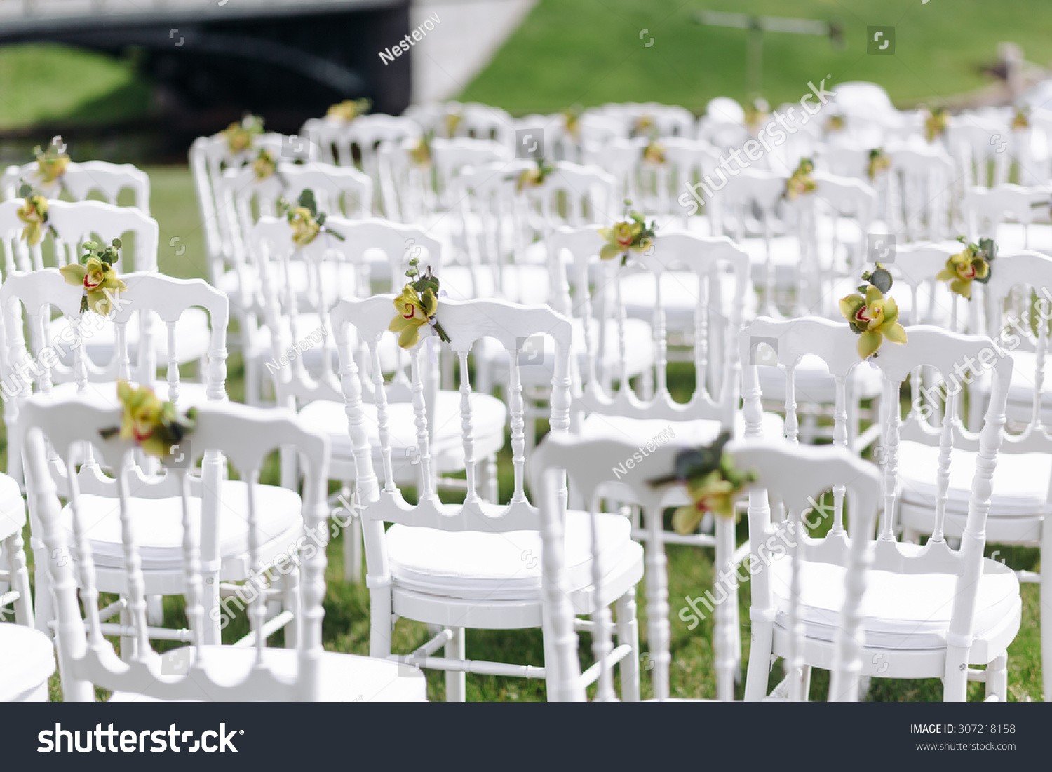 Wedding ceremony chair - White Chairs At A Wedding Ceremony Beautiful Wedding Set Up Luxury Wedding Flower Arrangement