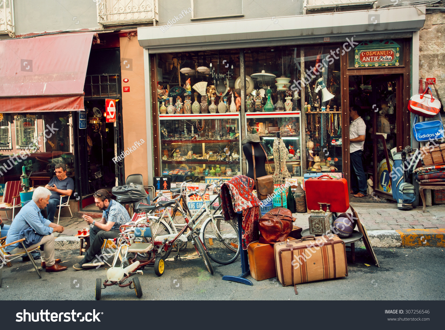 ISTANBUL   23 JULY: Antique Market And People Drinking Tea Near Vintage Furniture  Store On