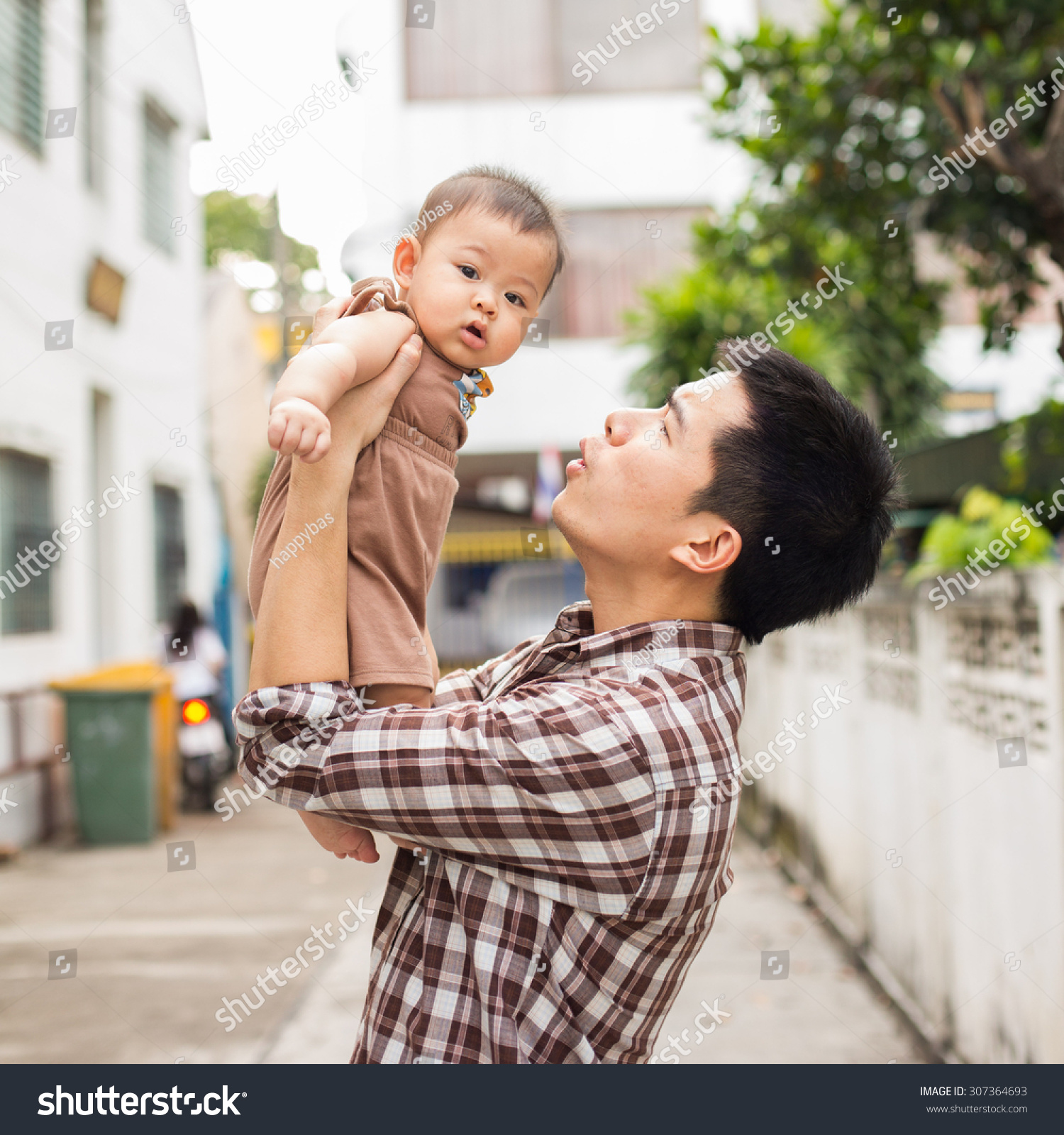 Father Carrying Baby Try Speak Him Stock Photo (Edit Now